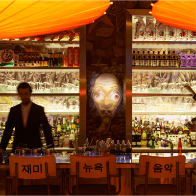 Miss Ko - Photograph of the bar with illustrated tapestry